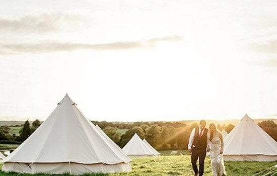 Stonor Park Accommodation Blue Bell Tents Couple Walking